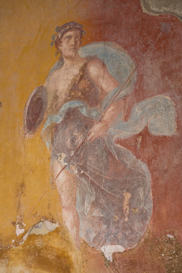 Fresco in Pompeii. Fresco from Pompeii, Italy. The mural depicts a young man (maybe a god royalty free stock image