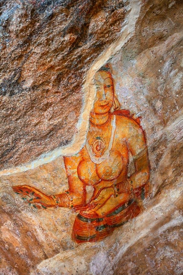 Fresco on rock surface. Woman portrait. Sigiriya, Polonnaruwa, S royalty free stock image