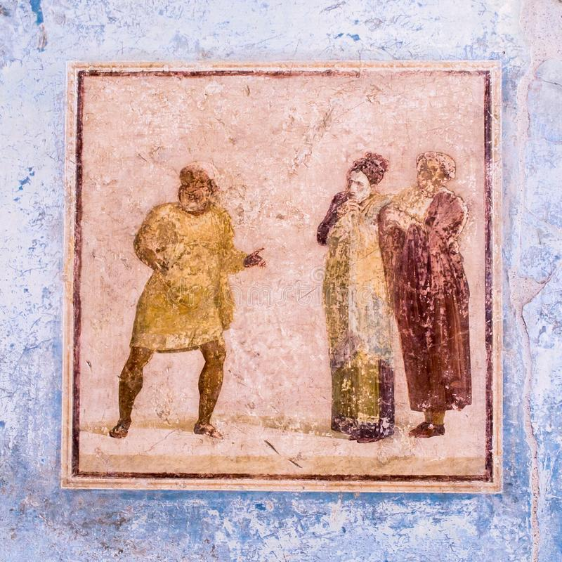 Ancient fresco showing theatre scene in Pompeii, Italy. Fresco showing a theatre scene in the House of Casca Longus or Quadretti Teatrali in historic town of royalty free stock photography