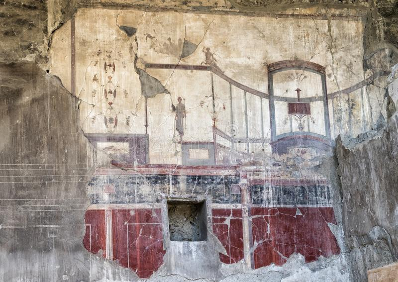 Fresco wall of house in Parco Archeologico di Ercolano royalty free stock photography
