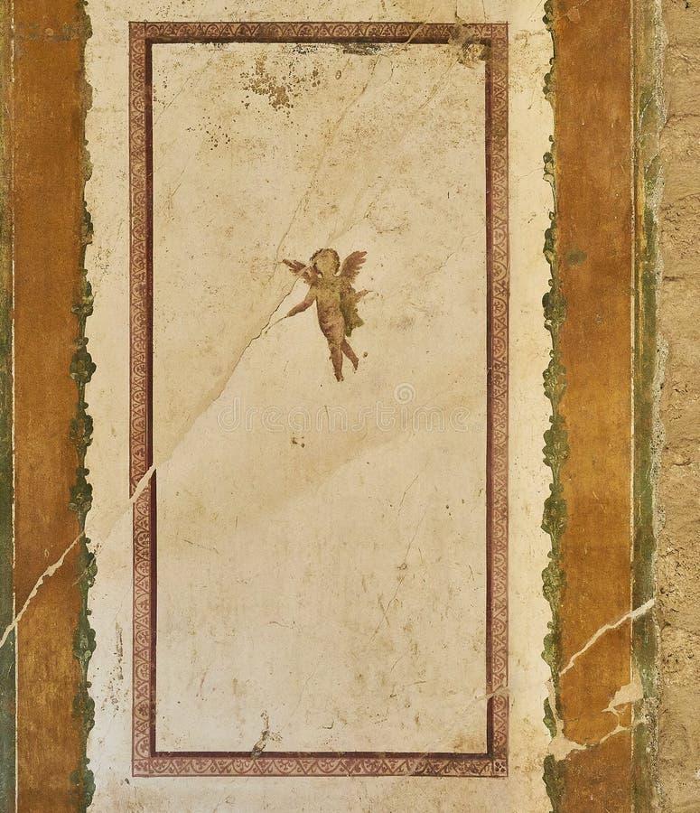 Ruins of Pompeii, ancient Roman city. Pompei, Campania. Italy. Fresco in a wall of House of Venus in the Shell Casa della Venere in Conchiglia at Ruins of stock images