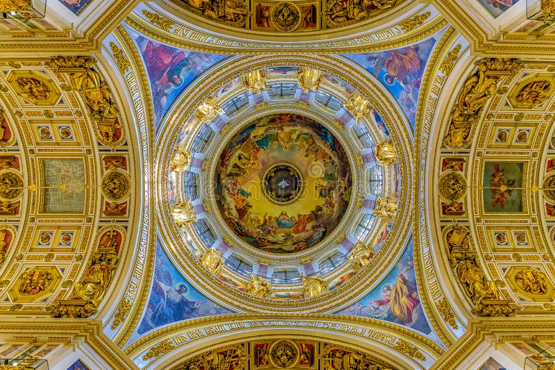 Fresco of white dove representing the Holy Spirit on Saint Isaac`s Russian Orthodox Cathedral`s dome in Saint Petersburg Russia stock photography