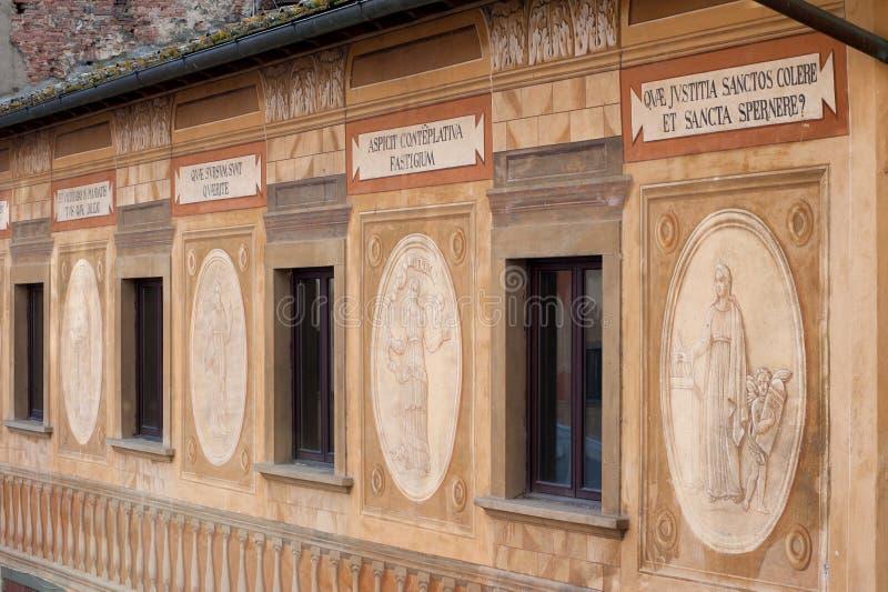 Frescoes on the facade of the Bishop's Seminary, San Miniato,. The frescoes and biblical mottos on the facade of the Bishop's Seminary, painted in royalty free stock photos
