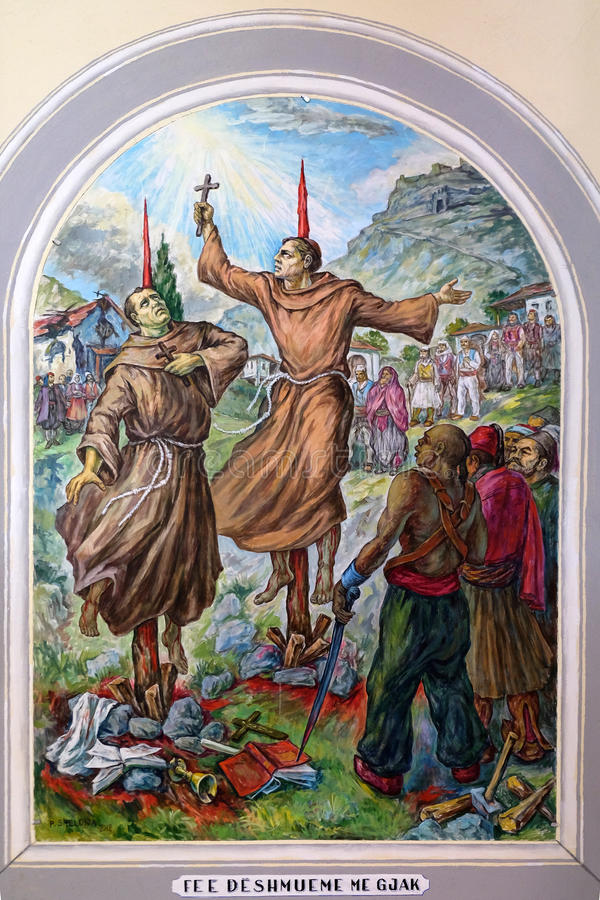 Frescoes in St Stephen`s Cathedral in Shkoder, Albania. Frescoes that depict the persecution of religion in socialist Albania, St Stephen`s Cathedral in Shkoder stock image