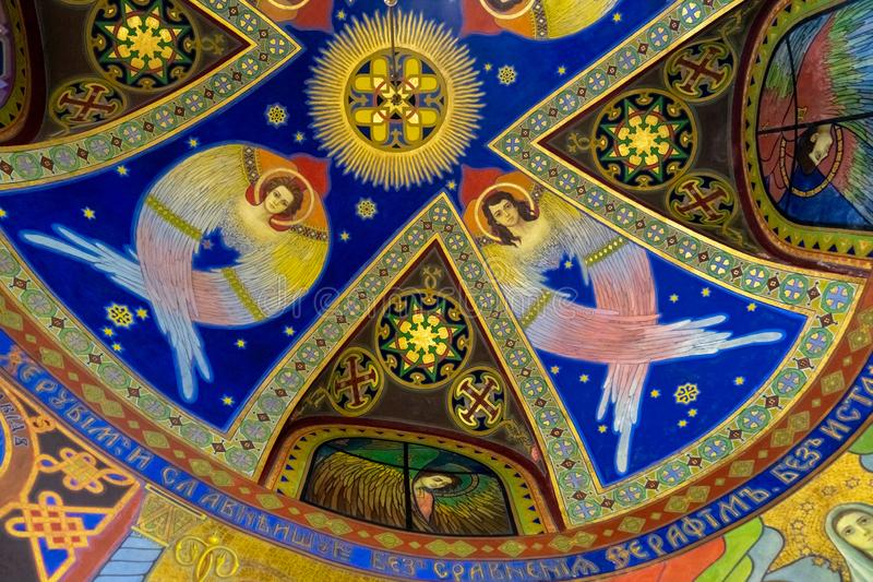 Frescos with angels on the ceiling of a chapel in the Ukrainian Greek Catholic Church of the Sacred Heart in Zhovkva, Ukraine. ZHOVKVA, UKRAINE - JANUAR 01, 2019 stock images
