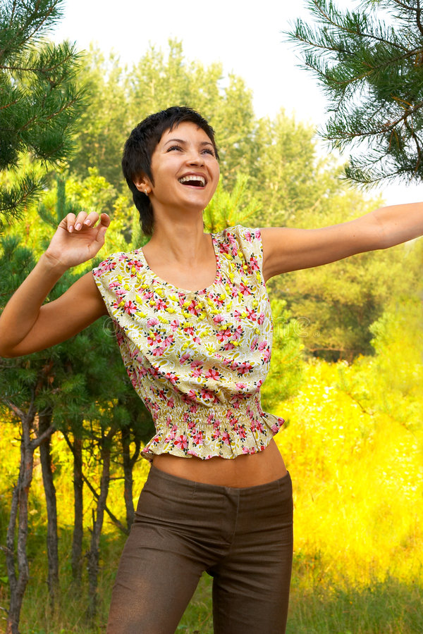 Fresh air!. Happy laughing woman enjoying nature
