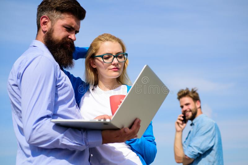 Fresh air helps to refresh mind. Colleagues laptop work outdoor sunny day, sky background. Friends enjoy fresh air and stock images