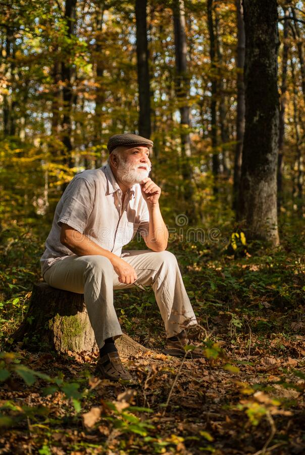 Fresh air. Idyllic moments. Grandpa vintage outfit in nature. Elderly people care. Nursing home. True values. Meaning of. Life. Nature is calling. Pensioner stock photo