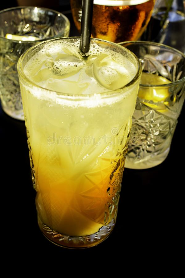 Fresh alcohol coctail drink on black background royalty free stock photo