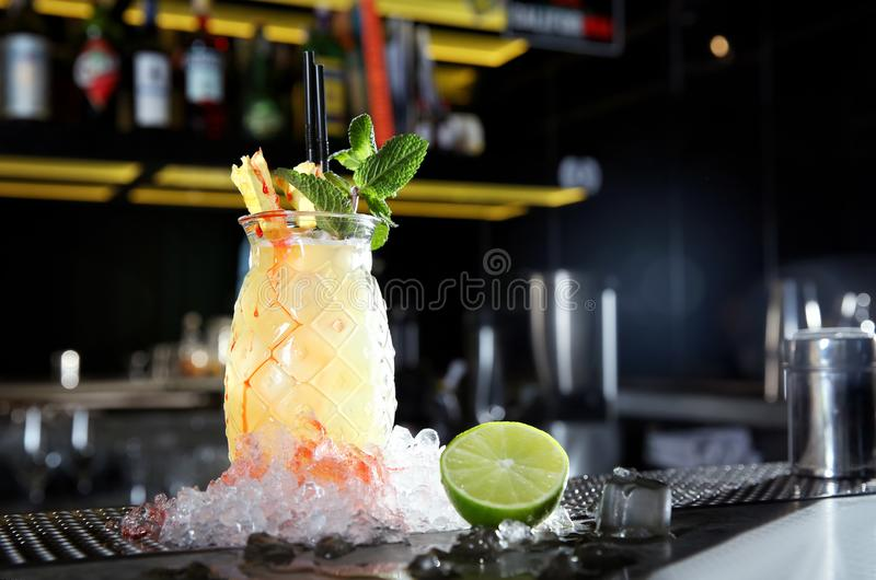 Fresh alcoholic Malibu and pineapple juice cocktail on bar counter. royalty free stock photo