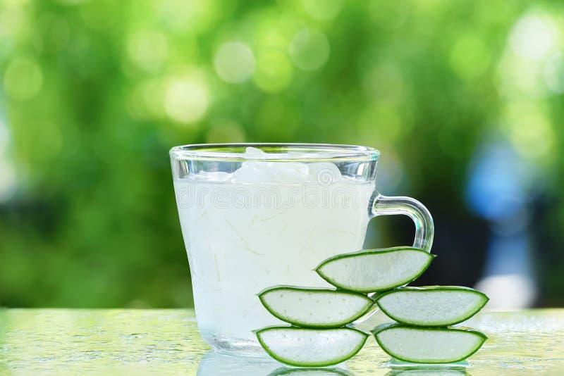 Fresh aloe vera leaves and aloe vera juice royalty free stock photos