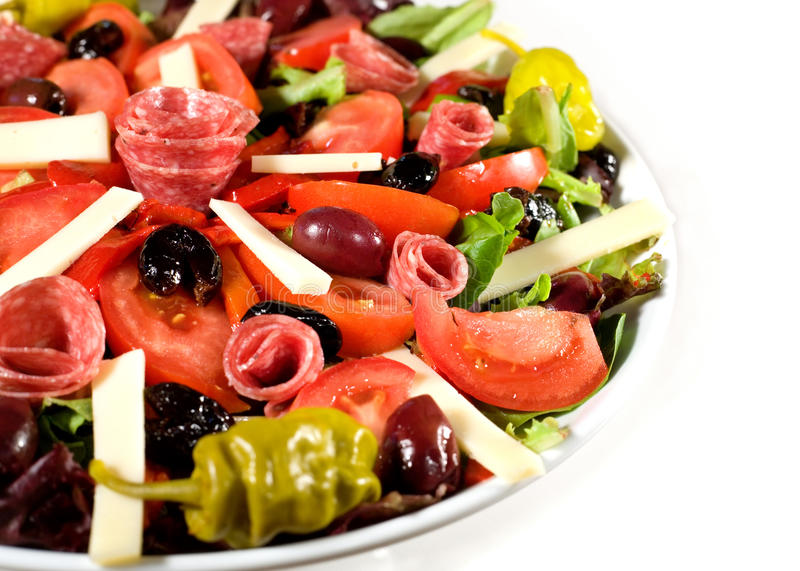Fresh Antipasto Salad. With cheese, lettuce, and olives royalty free stock photos