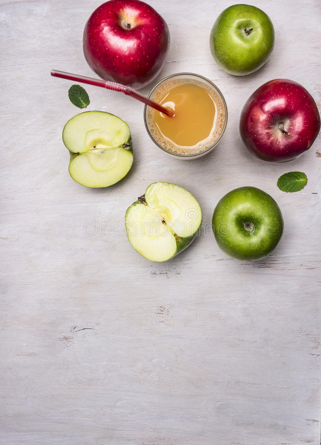 Fresh apple juice from apples of different varieties border ,place for text wooden rustic background top view close up stock image