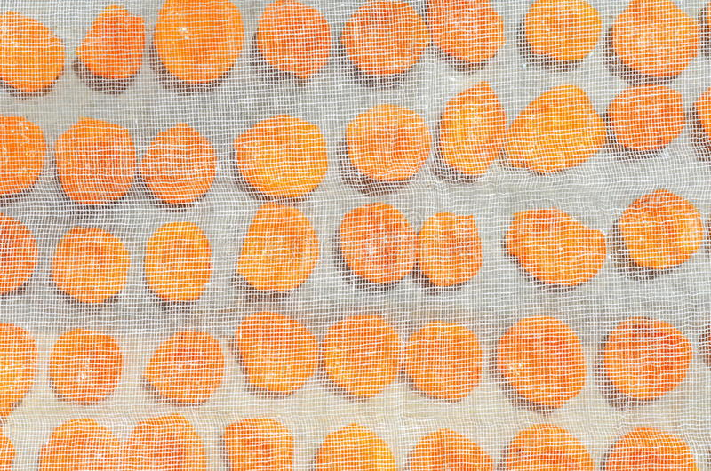 Fresh apricot halves, dried apricots cooking. Dried apricots. Technology of preparation of candied apricots royalty free stock photography