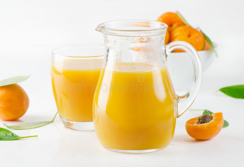 Fresh apricots juice. And apricots royalty free stock photos