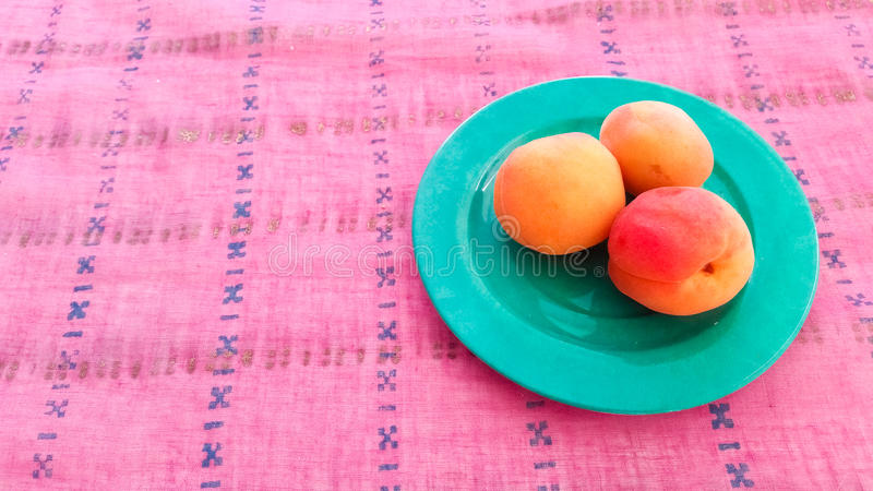 Fresh Apricots Served on a Table. Fresh Apricots Served in a Plate royalty free stock images