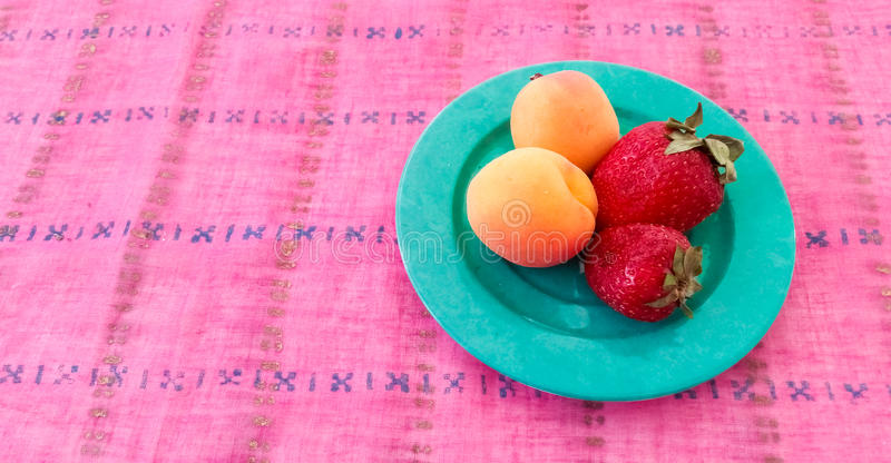 Fresh Apricots and Strawberries. Served in a Plate royalty free stock photo