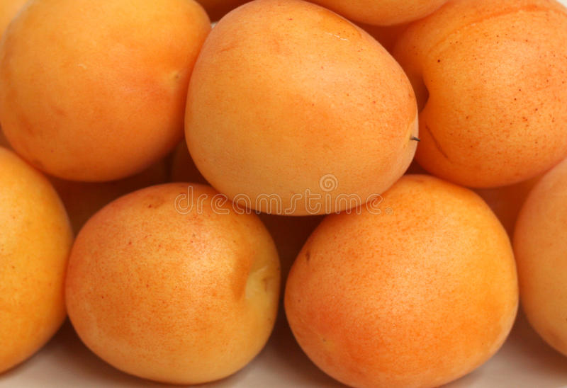 Fresh apricots. Fresh sweet apricots to background stock photos