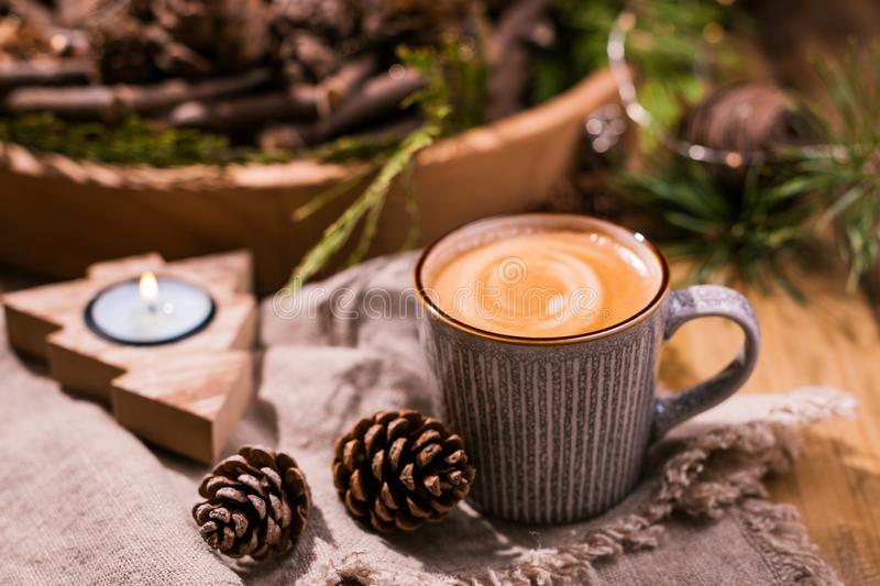 Fresh aromatic coffee and Christmas decor. Cozy festive atmosphere with candles and drinks. Free space for text stock images