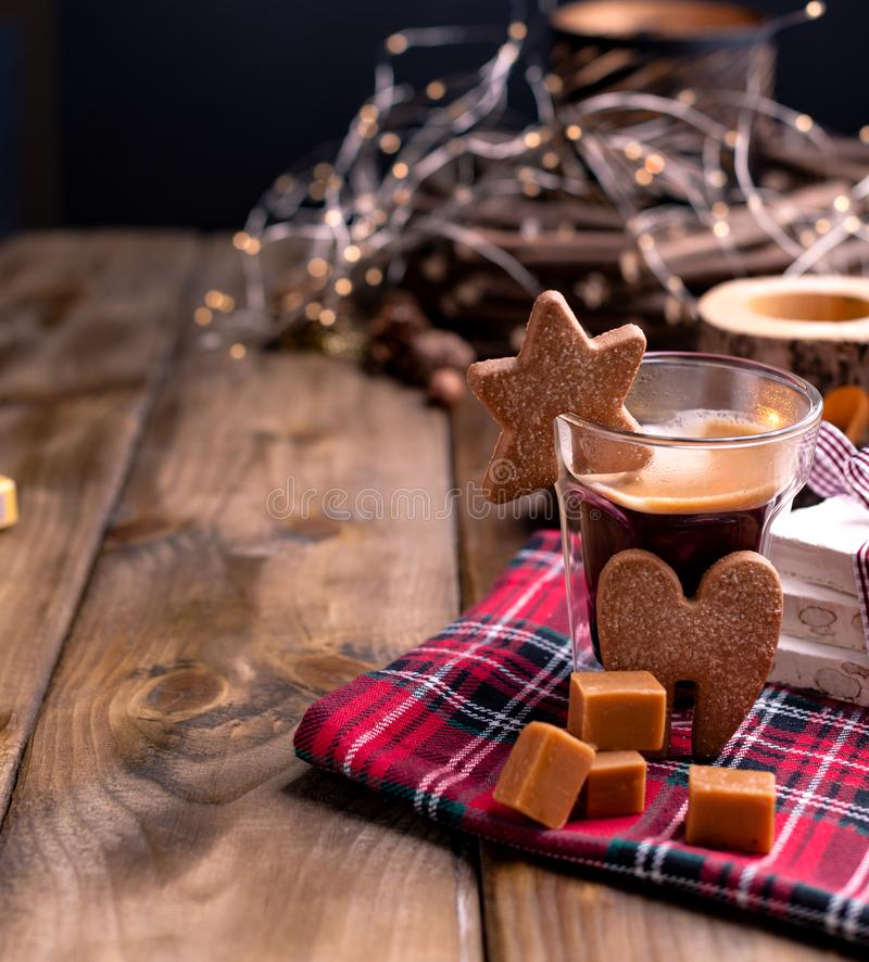 Fresh aromatic coffee and Italian Christmas sweets. Nougat with almonds, karemelnye sweets, ginger cookies and hot drink. Candles. And holiday decorations. Free stock photo