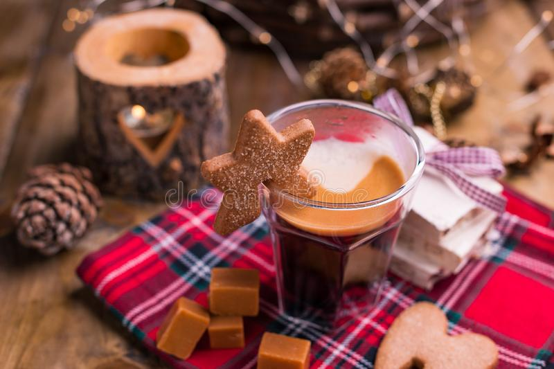 Fresh aromatic coffee and Italian Christmas sweets. Nougat with almonds, karemelnye sweets, ginger cookies and hot drink. Candles. And holiday decorations. Free royalty free stock photography