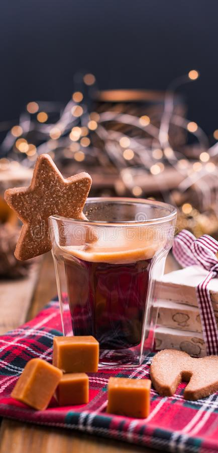 Fresh aromatic coffee and Italian Christmas sweets. Nougat with. Almonds, karemelnye sweets, ginger cookies and hot drink. Candles and holiday decorations. Free stock photos
