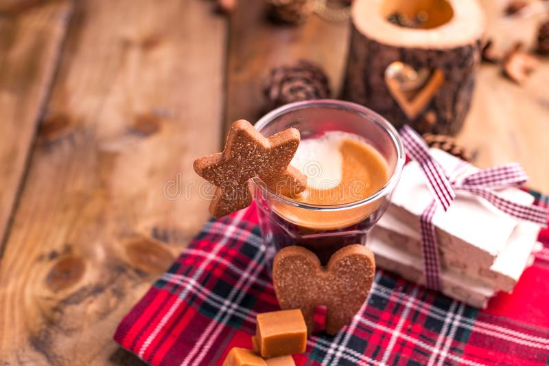 Fresh aromatic coffee and Italian Christmas sweets. Nougat with almonds, karemelnye sweets, ginger cookies and hot drink. Candles. And holiday decorations. Free royalty free stock photos
