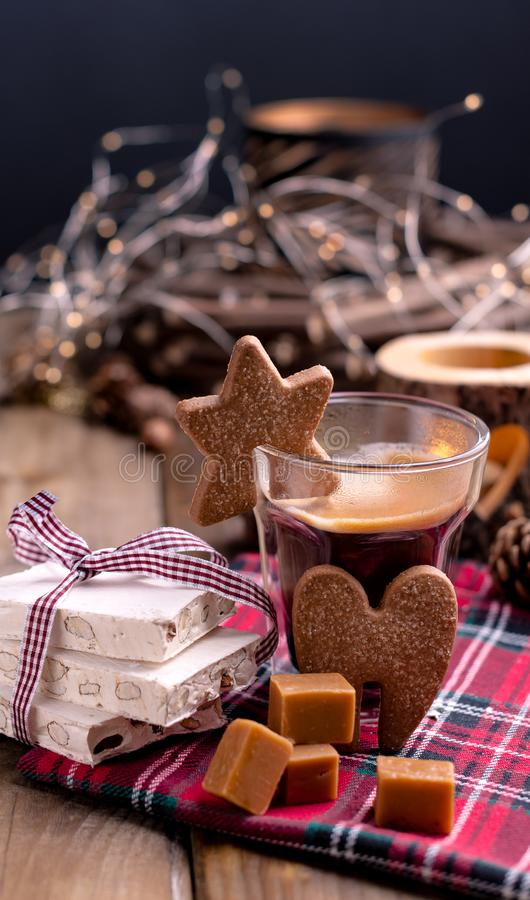 Fresh aromatic coffee and Italian Christmas sweets. Nougat with almonds, karemelnye sweets, ginger cookies and hot drink. Free. Space for te royalty free stock photography