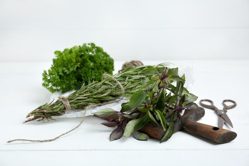 Fresh aromatic herbs on white table stock images