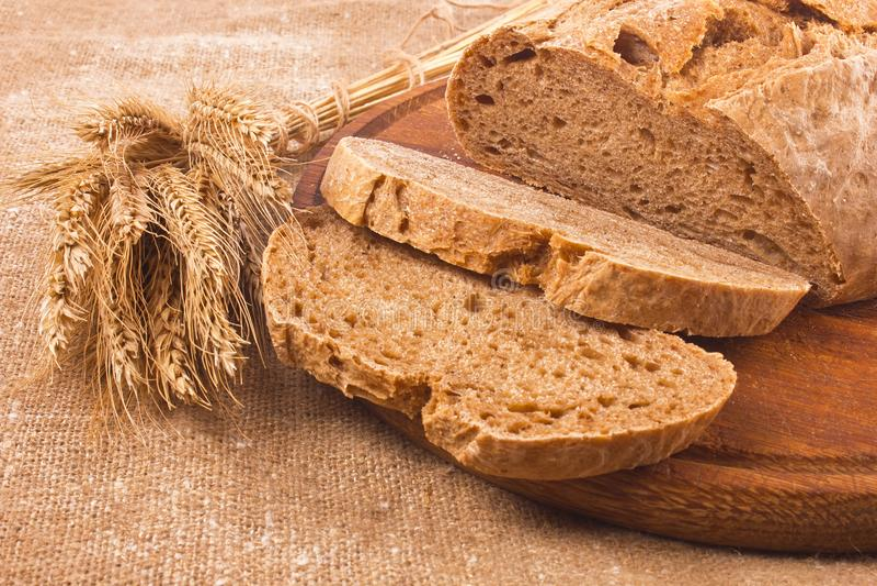 Fresh aromatic organic rye farm craft bread royalty free stock photo