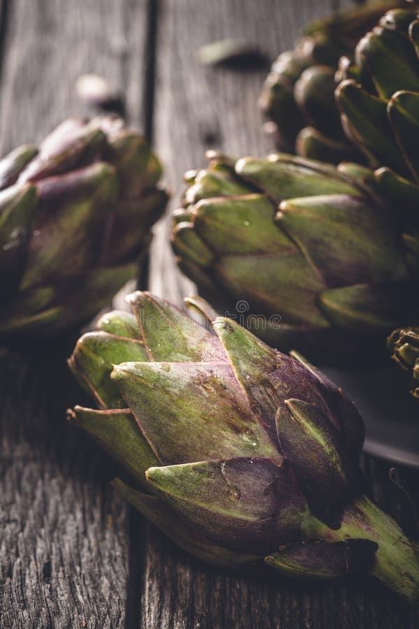 Fresh Artichoke. On wooden background royalty free stock image