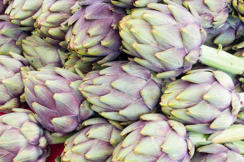 Fresh artichokes at the market stock photography