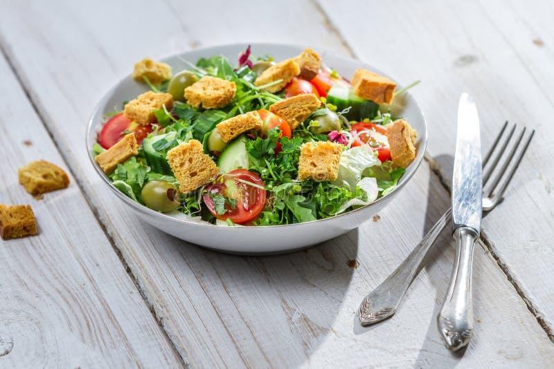 Fresh arugula salad with tomatoes royalty free stock image