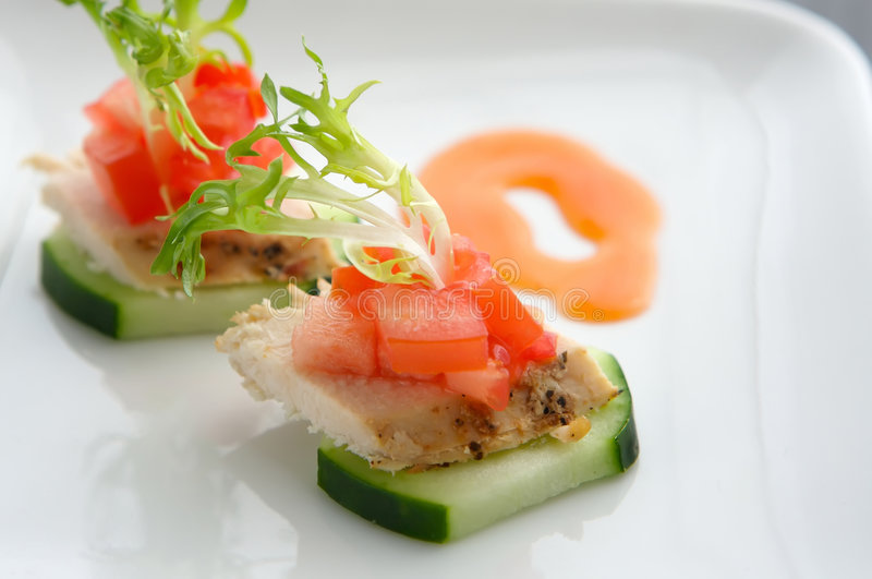 Fresh Asian Chicken salad appertizer. Lite Hors d'oeuvre of Chicken and cucumber stock photo