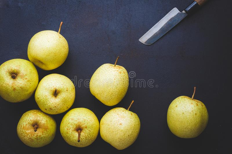 Fresh Asian pears on the dark background. Fresh  Asian pears from Asia. A fruit with special  taste, healthy eating stock image