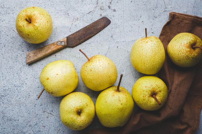 Fresh Asian pears on the dark background. Fresh  Asian pears from Asia. A fruit with special  taste, healthy eating royalty free stock image