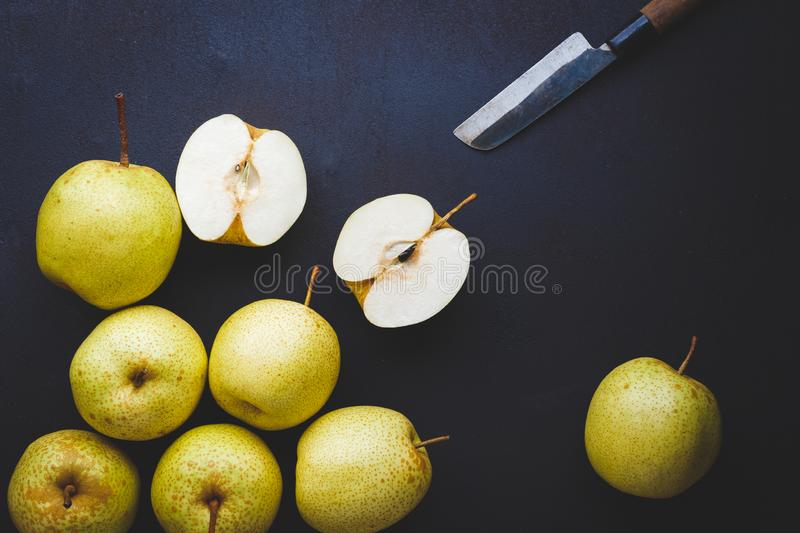 Fresh Asian pears on the dark background. Fresh  Asian pears from Asia. A fruit with special  taste, healthy eating royalty free stock photography