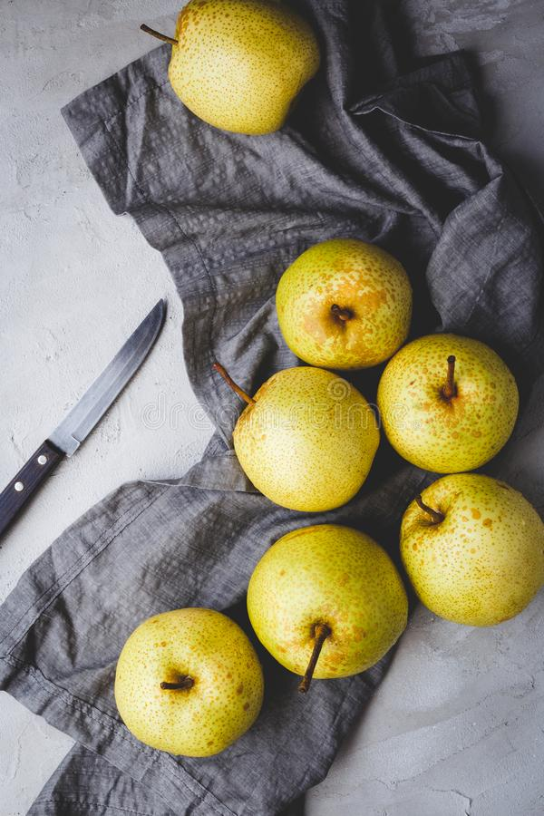 Fresh Asian pears on the dark background. Fresh  Asian pears from Asia. A fruit with special  taste, healthy eating stock photos