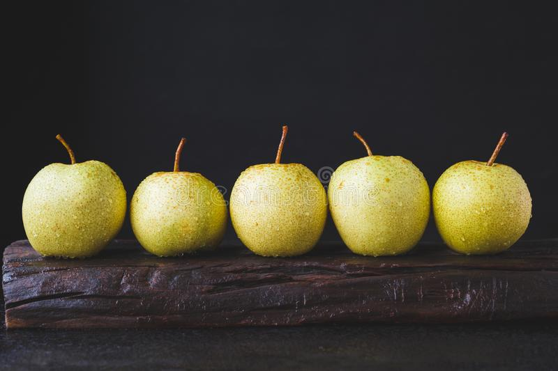 Fresh Asian pears on the dark background. Fresh  Asian pears from Asia. A fruit with special  taste, healthy eating stock images