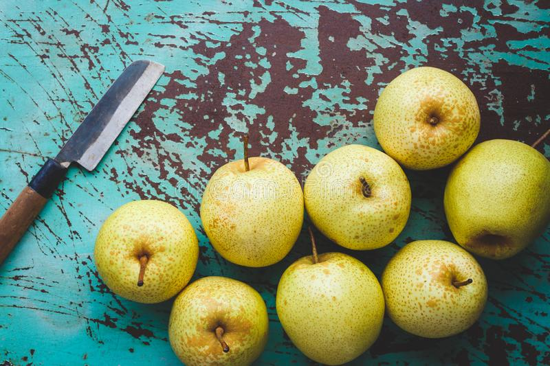 Fresh Asian pears on the dark background. Fresh  Asian pears from Asia. A fruit with special  taste, healthy eating royalty free stock photo