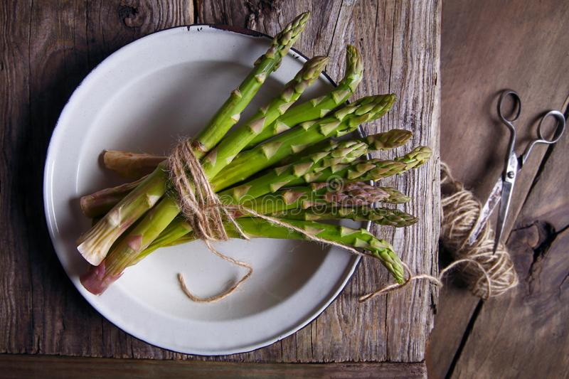 Fresh asparagus in a bowl stock photo