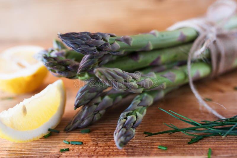 Fresh asparagus with lemon stock photography