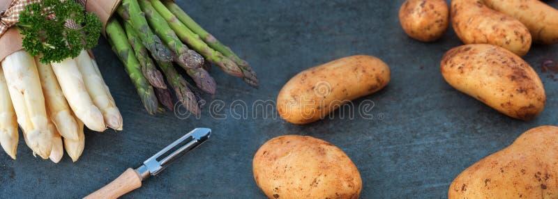 Fresh asparagus and potatoes royalty free stock photo