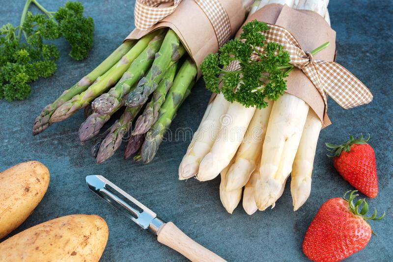 Fresh asparagus and strawberries royalty free stock images