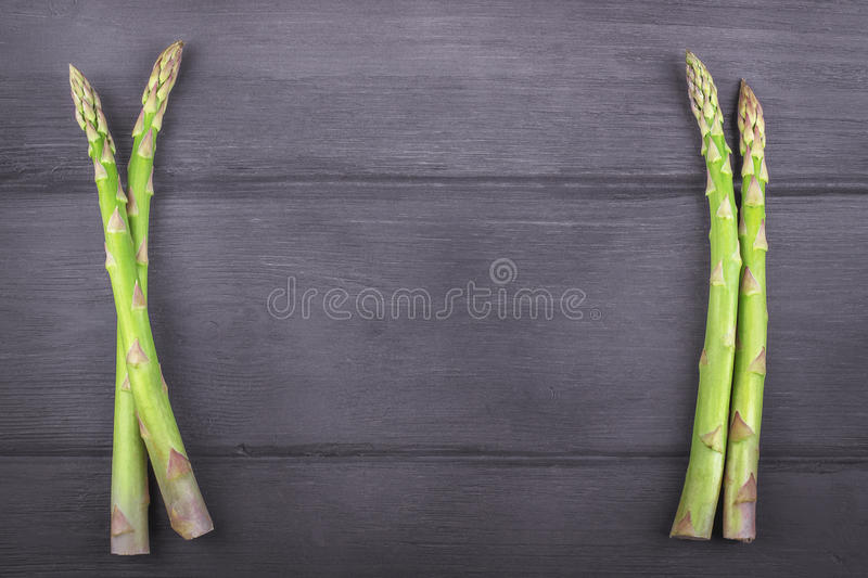 Fresh asparagus on wooden rustic background. Copy space stock photo