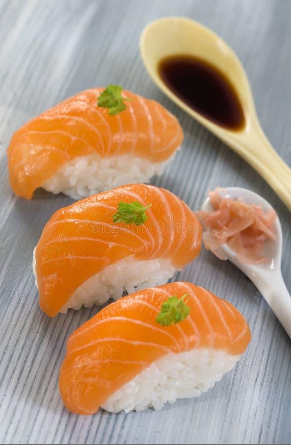 Fresh atlantic salmon Sushi with dressing. Fresh Atlantic salmon Sushi with soy sauce stock images