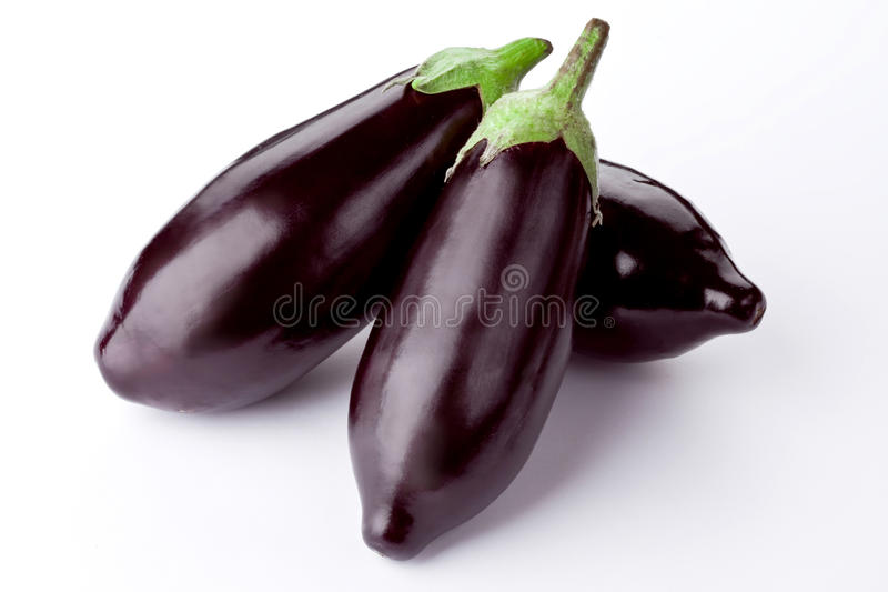 Fresh aubergine on a white. Background stock photography