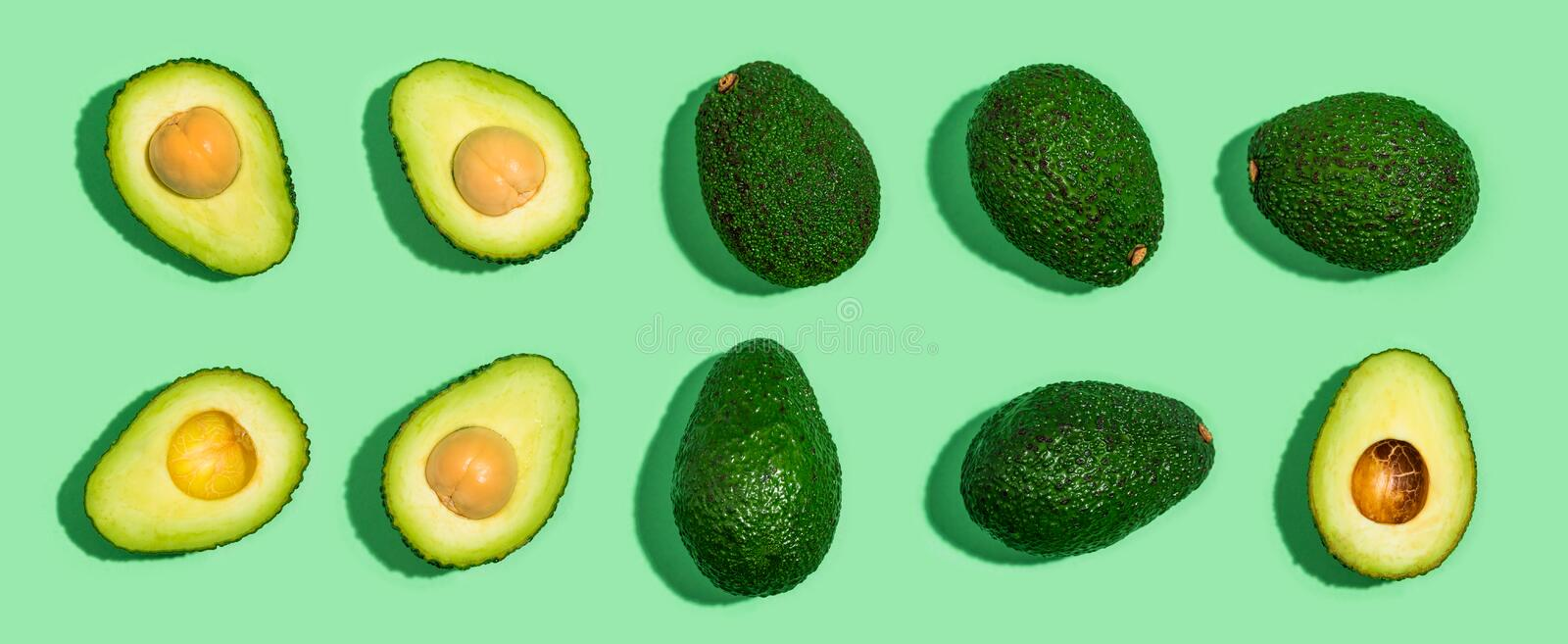 Fresh avocado pattern on a green background royalty free stock photos