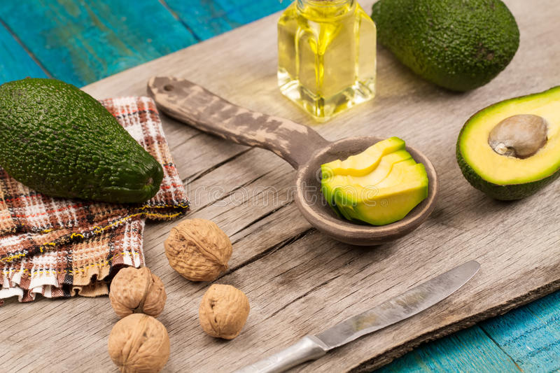 Fresh avocados on wooden background. Healthy food, diet. Vegetarian. Avocado oil royalty free stock photos