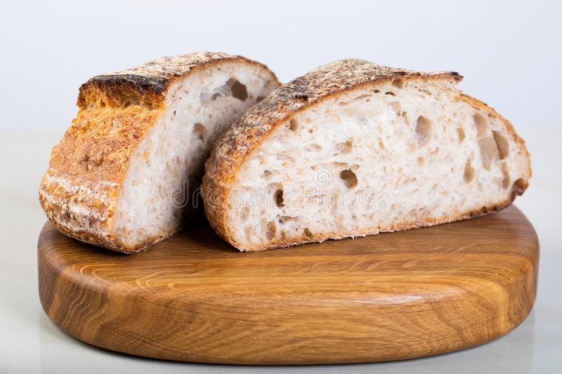 Fresh backed bread. Wholewheat bread on wooden cutting board stock images